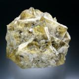 Fluorite with Quartz St. Peter's Mine. Sparty Lea, East Allendale, Northumberland, England, UK 12 cm across A cluster of amber-colored, untwinned  fluorite crystals up to 5 cm on edge. Recovered ca. 1996. (Author: Jesse Fisher)