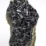 Epidote Khowrin Mount, Kohandan (East of Tafresh), central Iran Largest crystal: 1.2 cm. Height: 13.8 cm (Author: vhairap)