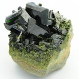 Epidote, Quartz Khowrin Mount, Kohandan (East of Tafresh), central Iran The largest crystal on top is 1.3cm in length. (Author: vhairap)