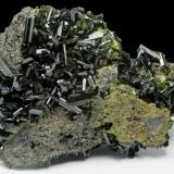 Epidote Khowrin Mount, Kohandan (East of Tafresh), central Iran The length of largest crystal in upper left is 1cm. (Author: vhairap)