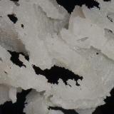 Quartz Level 7 United Mine, Maratoto, New Zealand 7.5x5cm A close up. (Author: Greg Lilly)