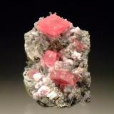 Rhodochrosite with fluorite, pyrite & apatite Nates Pocket, Sweet Home Mine, Alma, Colorado, USA 4.5x3.3cm This is my honeymoon rock, our honeymoon just happened to coincide with the Australian Gemboree :) (Author: Greg Lilly)