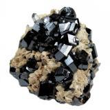 Cassiterite, siderite, quartz Viloco Mine, Araca, Loayza, La Paz, Bolivia  60 mm x 47 mm x 39 mm. Largest cassiterite crystal: 15 mm wide (Author: Carles Millan)