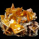 Wulfenite Rowley Mine, Painted Rock District, Theba, Painted Rock Mts., Maricopa County, Arizona, USA 48 x 38 x 35 mm up to 14 mm Wulfenites (Author: GneissWare)