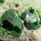 Andradite (var: Demantoid) Belqeys Mountain (Kuh-e-Belgheys), Takab, West Azarbaijan Province, Iran Larger crystal is 1.6 cm. The specimen is 5 cm in length. (Author: vhairap)