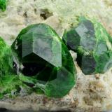 Andradite (var: Demantoid) Belqeys Mountain (Kuh-e-Belgheys), Takab, West Azarbaijan Province, Iran Larger crystal is 1.6 cm. The specimen is 5 cm in length (Author: vhairap)