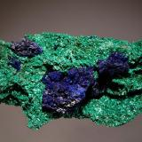 Azurite and Malachite Bou Bekker, Touissit, Oujda-Angad Province, Oriental Region, Morocco 5.0 x 10.6 cm. Dark blue crystallized azurite associated with almost fibrous green malachite. (Author: crosstimber)
