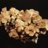 Vanadinite var. arsenian Zelidja Mine, Touissit, Oujda-Angad Province, Oriental Region, Morocco 4.5 x 7.5 cm. Barrel-shaped vanadinite crystals with slightly hoppered pinacoid terminations. (Author: crosstimber)