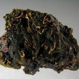 Gold on Uraninite with Cinnabar and Goldamalgam Anna adit, Mitterberg, Hochkönig, Salzburg, Austria 25 mm (Author: Gerhard Brandstetter)