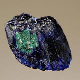 Azurite Kerrouchene, Khenifra Province, Meknes-Tafilalet Region, Morocco 2.6 x 3.7 cm. A single, dark blue azurite crystal with a small zone of malachite alteration. (Author: crosstimber)