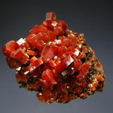 Vanadinite Mibladen, Khénifra Province, Meknes-Tafilalet Region, Morocco 5.2 x 5.9 cm. Lustrous red-orange hexagonal prisms to 1.0 cm on brown matrix. (Author: crosstimber)