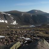 The Cairngorms in early June this year. Still quite a lot of the winter's snow about. On the plus side there were no midges. The mountain in the distance is called 'Cairngorm', after which the range of mountains is named. It's summit is 1244m, over 4,000 ft above sea level. Everywhere is granite. (Author: Mike Wood)