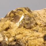 Beryl + Microcline + Smoky Quartz + Muscovite Ben a' Bhuird, Cairngorm Mountains, Grampian Region, Scotland, UK 10cm x 7cm x 3cm Close-up of the above specimen. The beryl crystal reflecting the light is 10mm long. (Author: Mike Wood)