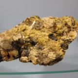 Beryl + Microcline + Smoky Quartz + Muscovite Ben a' Bhuird, Cairngorm Mountains, Grampian Region, Scotland, UK 10cm x 7cm x 3cm Random lump of pegmatite found on it's own on the ground. The beryl crystals are a strong yellow colour but are opaque. (Author: Mike Wood)