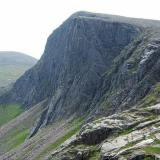 Carn Etchachan (1120m) and Shelter Stone Crag, at the head of Loch Avon in the Cairngorms. The cliff is about 800 feet high (~250m) and is popular for hard climbers, both in summer and in winter. (Author: Mike Wood)