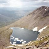 Lochan Uaine, about 1.5km southeast of Ben Macdui in the Cairngorms, one of the highest lochans (small lake) in the UK at over 950m above sea level. But even I was surprised to see icebergs floating on it, in late June!! Don't know for sure if it contains trout, but I bet it does. Photo taken June 1994 (scanned from print), M.Wood. (Author: Mike Wood)