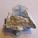 Barite Milpillas Mine, Cuitaca, Santa Cruz, Sonora Mexico 10 b 7 cm.  barite is 5 cm Pale blue barite on clay coated breccia matrix  Peter Megaw specimen and photograph...  Thanks Jesus! (Author: Peter Megaw)