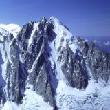 L'Aiguille Verte (4122m) north face, seen across Glacier D' Argentière from the summit of Le Aiguille D' Argentière (3999m). les Droites is to the left, even more impressive a sight. Photo taken 1992. Scanned from slide. (Author: Mike Wood)