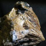 Titanite Kola Peninsula, Russia section: 5 x 5 cm (entire piece: 7 x 5 x 4 cm - loaded in my album in the Spanish FMF)  Not a specifically alkaline mineral, but in a pretty unusual habit. (Author: kakov)