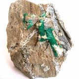 Emerald (with some minor pyrite and calcite) Chivor Mine, Mun. de Chivor, Guavió-Guatéque Mining District, Boyacá Department, Colombia Specimen size 7 cm, largest crystal 2,5 cm (Author: Tobi)