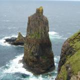 "Macleods' Maidens, Duirinish, Isle of Skye, Scotland. Sixty metres (~190 feet) tall The sea-stack ( ""cliff "" ) that Steve McQueens' double jumped off in the classic film 'Papillon'. (Author: Mike Wood)"