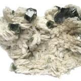 Fluorapatite on albite Sapo Mine, Ferruginha, Conselheiro Pena, Doce valley, Minas Gerais, Brazil Specimen size 11 cm, largest apatite crystal 1,5 cm (Author: Tobi)