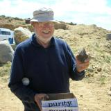 John S. White scored early with a fine amethyst quartz floater.  Don't let the name on the box fool you.  John is not pure except in knowledge!  Ha, ha! (Author: Tony L. Potucek)