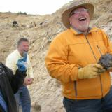 "John Veevaert on the left is expressing his ""disappointment"" to mucho ebullient Nick Skirkanich upon Nick finding another fine quartz head.  Dan Kennedy is in the background, finding a lot of humor in the moment. (Author: Tony L. Potucek)"