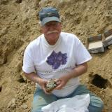 Ken Roberts, veteran mineral dealer, with another quartz find. (Author: Tony L. Potucek)