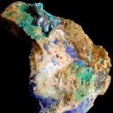 Tyrolite Delfina Mine (Alda mine; Minona), Hoyos de Alda, Ortiguero, Prado, Cabrales, Asturias, Spain. 5,8x5,5cm. Group of crystals; 1,3 cm. The crystals are definifos 0.6 cm and finished at the ends. (Author: DAni)