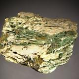 Actinolite Roccamonfina, Caserta, Campania, Italy 6.5 x 7.0 cm Bundles of acicular olive-green actinolite embedded in white talc. (Author: crosstimber)