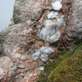 Ben Loyal, Sutherland, Scotland I came across this section of pegmatite vein, which wasn't exotic, merely containing pink microcline and quartz, and not showing any euhedral crystals. But it showed I was getting warmer.. (Author: Mike Wood)