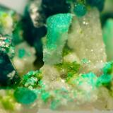 Dioptase, calcite and duftite. Tsumeb, Namibia Field of view, approx. 10 mm Same specimen as above. (Author: Pierre Joubert)