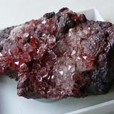Quartz and hematite Goose Green Mine, Frizington, Cumbria, England, UK 3.5 x 2 x 1cm  24g. Red quartz crystals on hematite matrix (Author: captaincaveman)