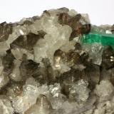 Beryl (variety emerald), Calcite, Quartz<br />Coscuez mining district, Municipio San Pablo de Borbur, Western Emerald Belt, Boyacá Department, Colombia<br />Detail - FOV=7cm<br /> (Author: Fiebre Verde)
