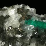 Beryl (variety emerald), Calcite, Quartz<br />Coscuez mining district, Municipio San Pablo de Borbur, Western Emerald Belt, Boyacá Department, Colombia<br />Detail - FOV=6cm<br /> (Author: Fiebre Verde)