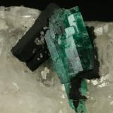 Beryl (variety emerald), Calcite<br />Muzo mining district, Western Emerald Belt, Boyacá Department, Colombia<br />60x45x28mm<br /> (Author: Fiebre Verde)