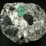 Beryl (variety emerald), Calcite, Pyrite<br />Muzo mining district, La Pava Mine, Quípama, Municipio Muzo, Western Emerald Belt, Boyacá Department, Colombia<br />xl=7mm<br /> (Author: Fiebre Verde)