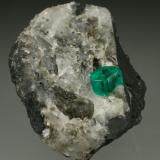 Beryl (variety emerald), Calcite, Pyrite<br />Chivor mining district, Municipio Chivor, Eastern Emerald Belt, Boyacá Department, Colombia<br />35x45mm, xl=6mm<br /> (Author: Fiebre Verde)