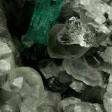 Beryl (variety emerald), Calcite, Quartz<br />La Pita mining district, Municipio Maripí, Western Emerald Belt, Boyacá Department, Colombia<br />Emerald crystal is 11mm long<br /> (Author: Fiebre Verde)