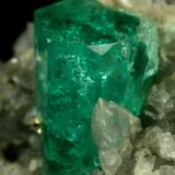 Beryl (variety emerald), Calcite, Pyrite<br />Muzo mining district, Western Emerald Belt, Boyacá Department, Colombia<br />xl=14mm<br /> (Author: Fiebre Verde)