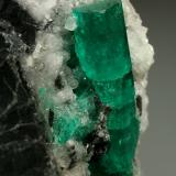 Beryl (variety emerald), Calcite<br />Muzo mining district, Western Emerald Belt, Boyacá Department, Colombia<br />28x51x49mm, xl=30mm<br /> (Author: Fiebre Verde)