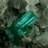 Beryl (variety emerald), Calcite, Pyrite<br />Chivor mining district, Municipio Chivor, Eastern Emerald Belt, Boyacá Department, Colombia<br />40x42x42mm, xl=18mm<br /> (Author: Fiebre Verde)