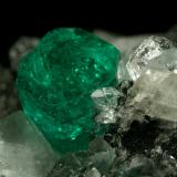 Beryl (variety emerald), Calcite, Quartz<br />Muzo mining district, Western Emerald Belt, Boyacá Department, Colombia<br />60x46x42mm, xl=13mm<br /> (Author: Fiebre Verde)