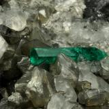 Beryl (variety emerald), Calcite, Pyrite<br />Chivor mining district, Municipio Chivor, Eastern Emerald Belt, Boyacá Department, Colombia<br />65x50x70mm, xl=18mm<br /> (Author: Fiebre Verde)