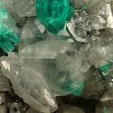 Beryl (variety emerald), Calcite, Quartz<br />La Pita mining district, Polveros Mine, Municipio Maripí, Western Emerald Belt, Boyacá Department, Colombia<br />53x51x40mm, xl=9mm<br /> (Author: Fiebre Verde)
