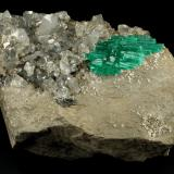 Beryl (variety emerald), Calcite, Pyrite, Albite<br />Chivor mining district, Municipio Chivor, Eastern Emerald Belt, Boyacá Department, Colombia<br />85x65x40mm, cluster=32x19mm<br /> (Author: Fiebre Verde)