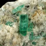 Beryl (variety emerald), Calcite, Aragonite<br />Chivor mining district, Municipio Chivor, Eastern Emerald Belt, Boyacá Department, Colombia<br />80x70x65mm, main xl=18mm<br /> (Author: Fiebre Verde)