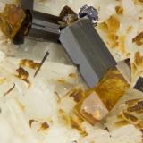 Titanite, Amphibole Group Mineral, MolybdneiteCantera Poudrette, Mont Saint-Hilaire, La Vallée-du-Richelieu RCM, Montérégie, Québec, CanadáFOV = 4mm (Author: Doug)