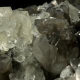 Beryl (variety emerald), Calcite, Fluorite<br />La Pita mining district, Municipio Maripí, Western Emerald Belt, Boyacá Department, Colombia<br />Fluorite largest side=17mm<br /> (Author: Fiebre Verde)